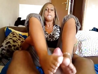 Sexy German Blonde gives a nice Footjob