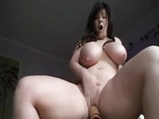 Curvy german girl rides a dildo