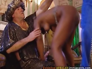 Ebony slave pleases her master in orgy