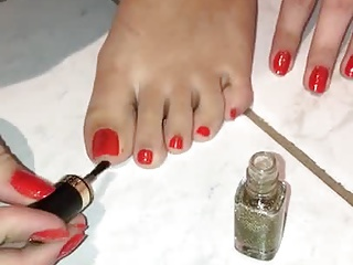 Doris put new and fresh nail polish on sexy toes